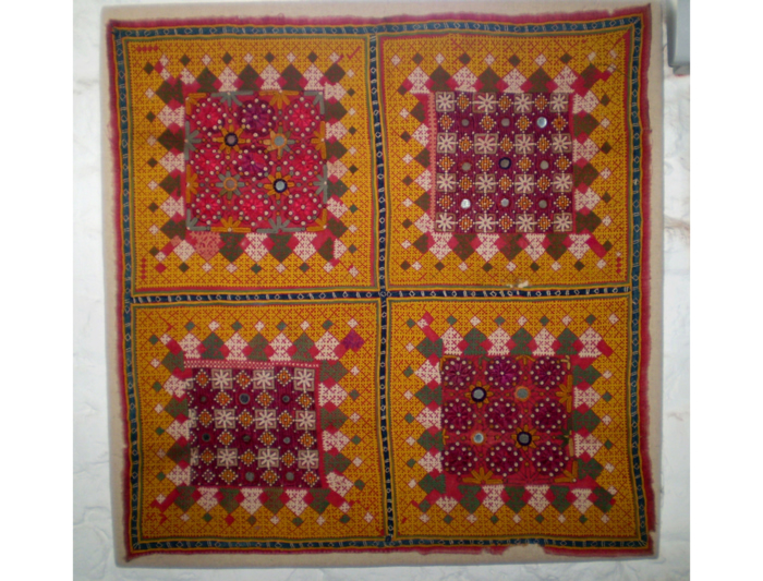 An Indian embroidered textile - 58 x 58cm